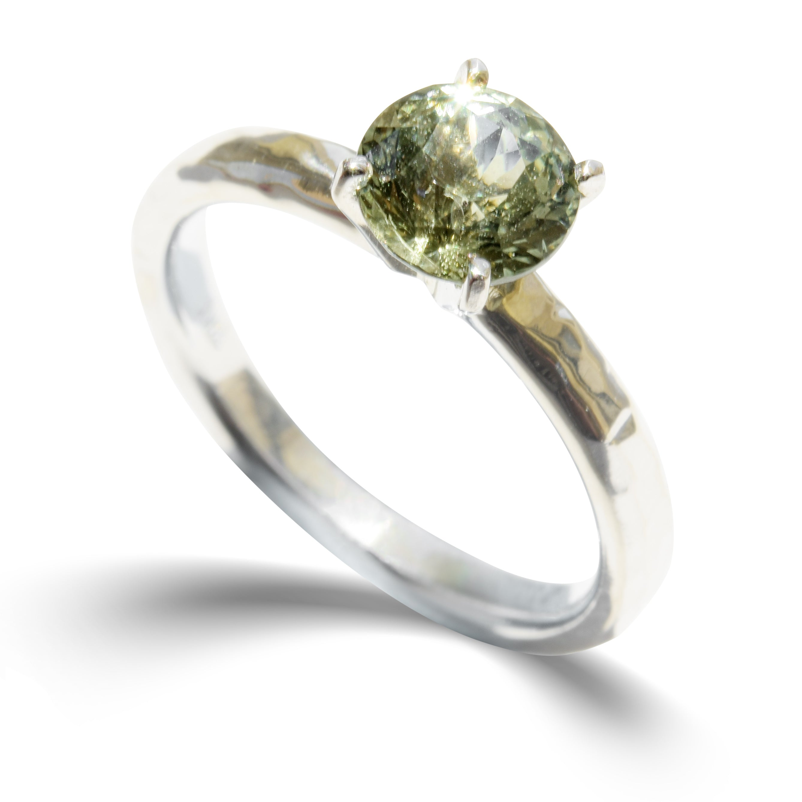 Hammered 14k white gold ring with a 7mm mermaid lime sapphire held by four prongs