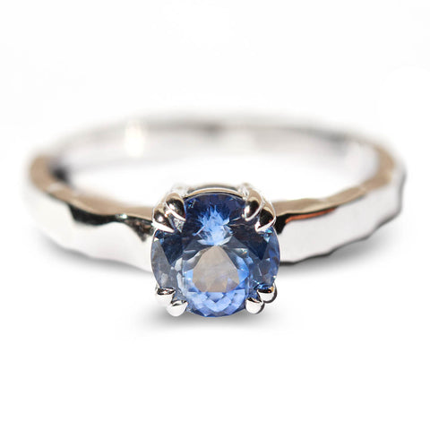 Ice blue sapphire solitaire engagement ring with double prongs and hammered band