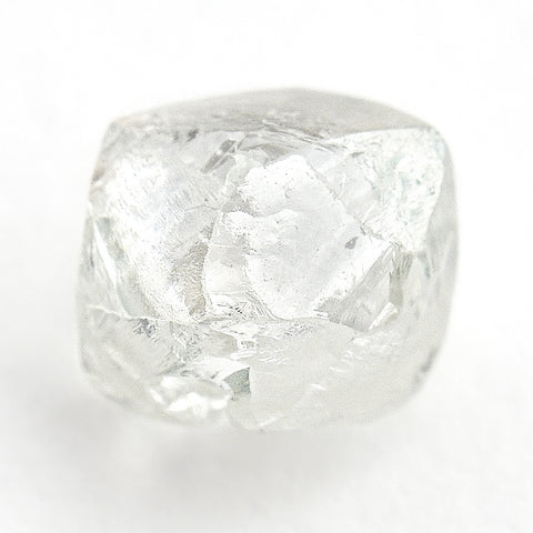 0.91 carat shiny and light filled raw diamond rhombododecahedron