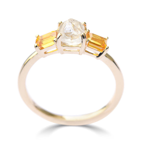 The Keren ring model - a rough diamond engagement ring with two bright apricot sapphires