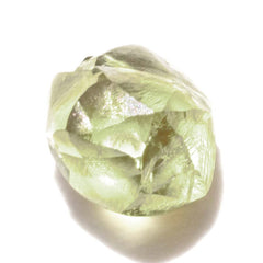 0.78 carat shimmery olive green rough diamond rhombododecahedron