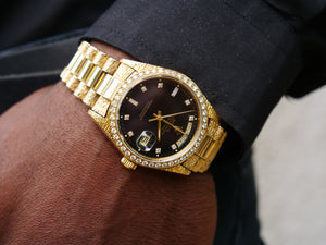 Rolex day date 18ct gold with factory set diamond dial and bezel