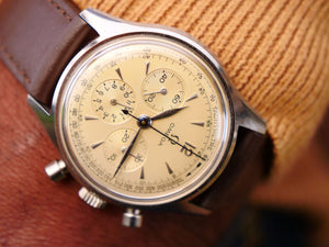Omega chronograph Ref 2451 with extract from the archives