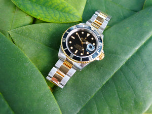 Rolex submariner 18ct Gold and steel with box and papers
