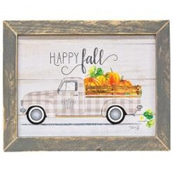 "Grey distressed mitered frame around a vintage inspired wooden sign. Sign displays old farm truck with wood rail along the truck bed. Truck is patterned with a plaid pattern and white wall tires. Truck bed full of pumpkins of various sizes. Decorative ""Happy Fall"" scrolled across the top of the wood sign."