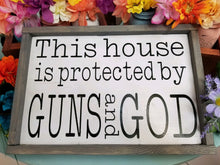 Load image into Gallery viewer, This house is protected by Guns and God, rustic farmhouse decor, wall art, ready to ship