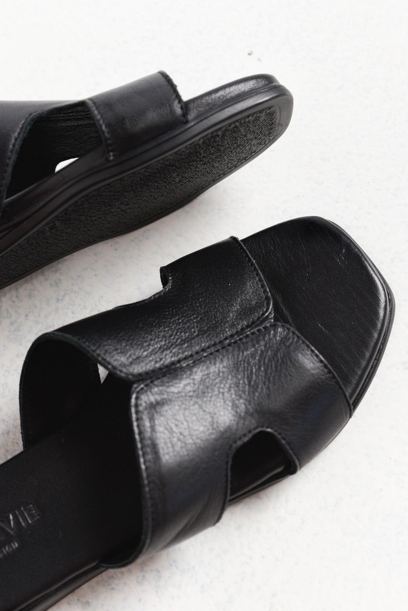 Slippery Black Leather Slide
