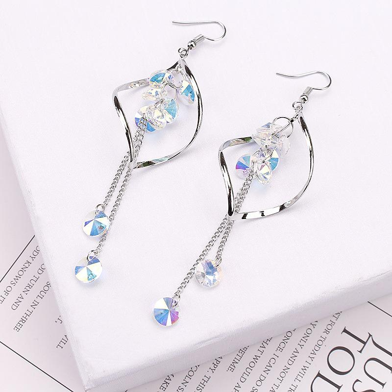 Wavy long crystal earrings
