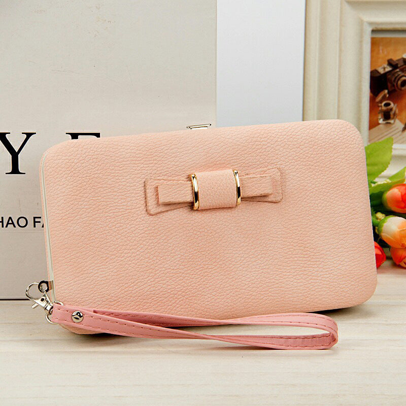 Factory spot low price wholesale new Korean version of women's wallet in the long money bag butterfly knot lunch box woman bag tide