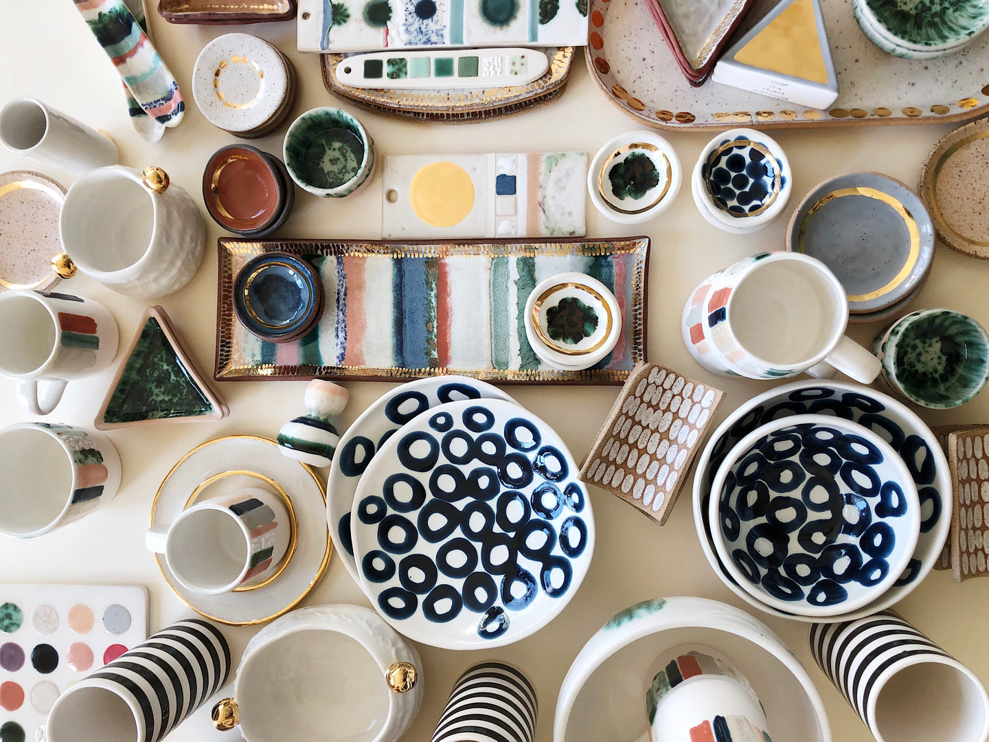 A collection of colorful and gold hand made ceramics by the Object Enthusiast
