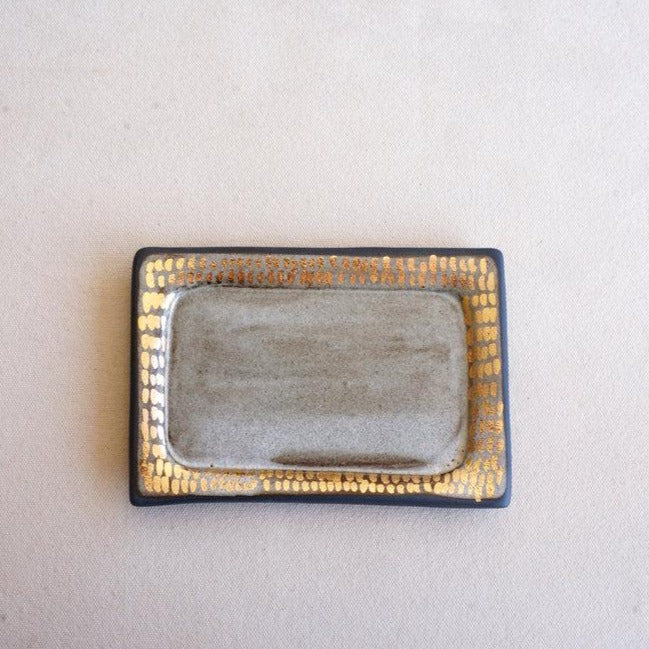 Rectangular handmade ceramic hand-painted tray in white and gold used to hold jewelry, incense, sage, or other small collectibles