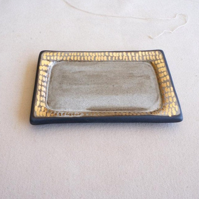 Another angle of the matte white and gold handmade ceramic jewelry tray made by The Object Enthusiast