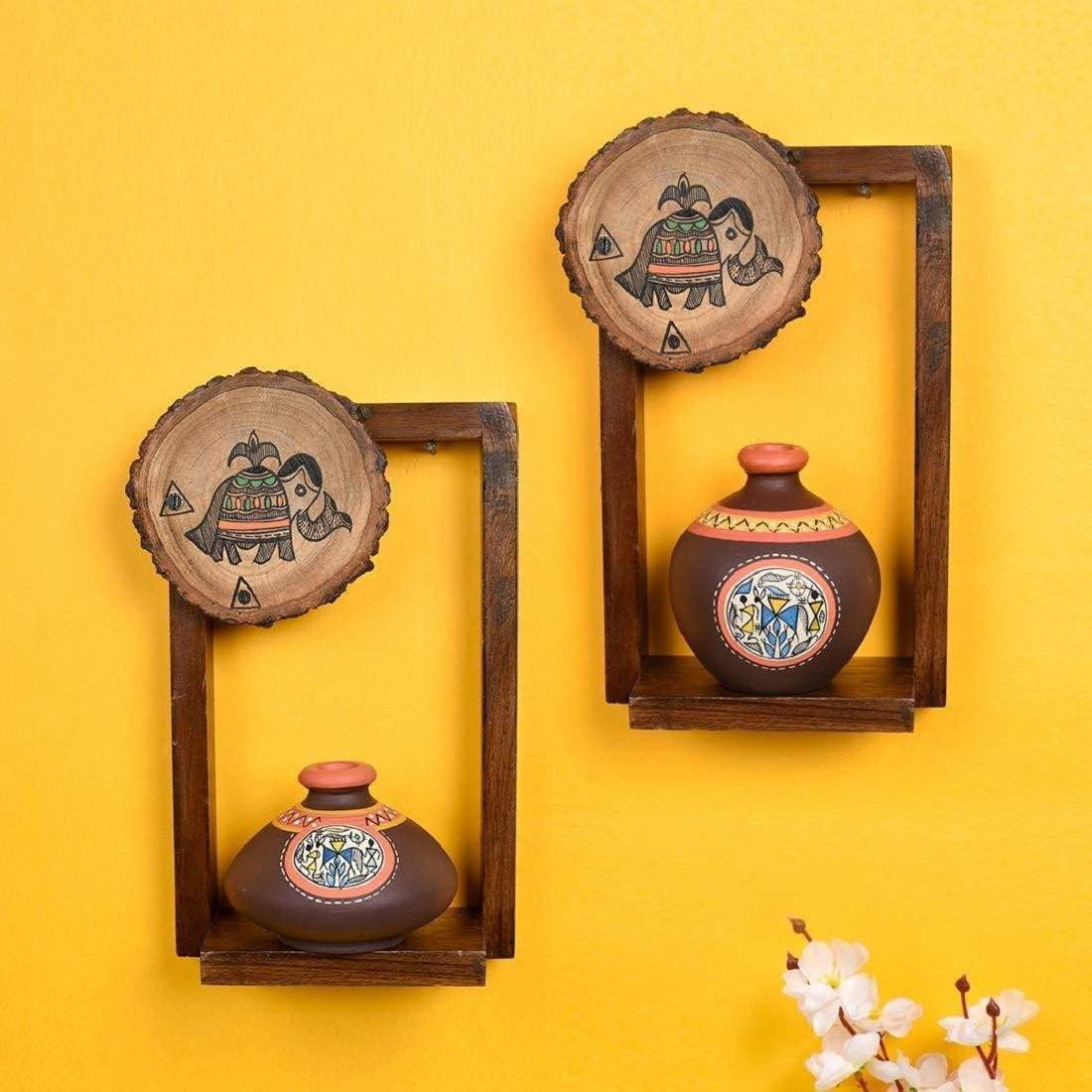 Decorative Wall Shelves With Brown Terracotta Vases.