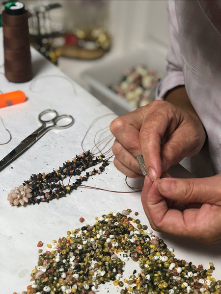 "The ""colareiras"", shells necklace makers who gather the shells on the beaches and hand-embroidered our shells flowers and jewelry in O Grove (Galicia)"