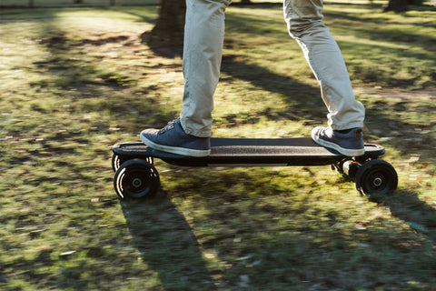 electric skateboard at speed on grass