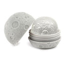Moon inspired silicone ice ball mold for craft cocktails and spirits.