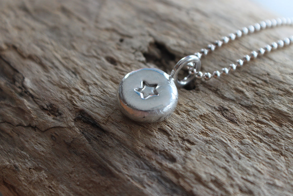 Hand stamped Lucky Star memory jewelry.