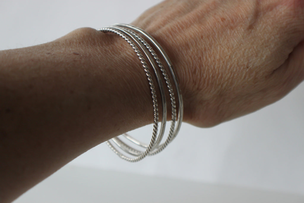 stacking bangles on wrist by SFDesigns