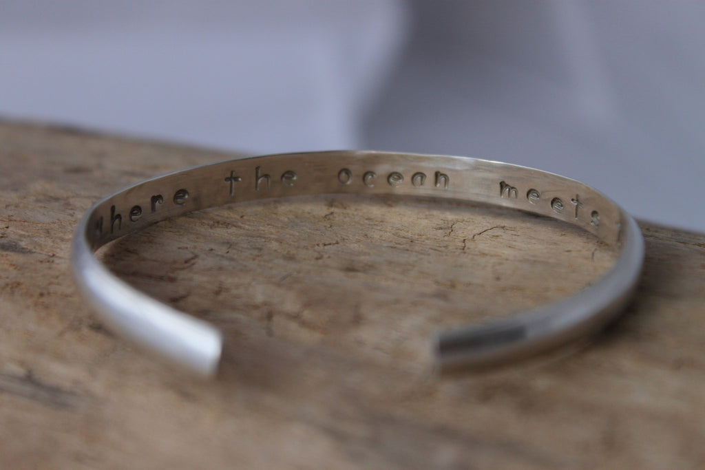 hand stamped hidden message cuff by SFDesigns