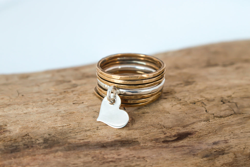 gold stacking rings with silver floating heart ring