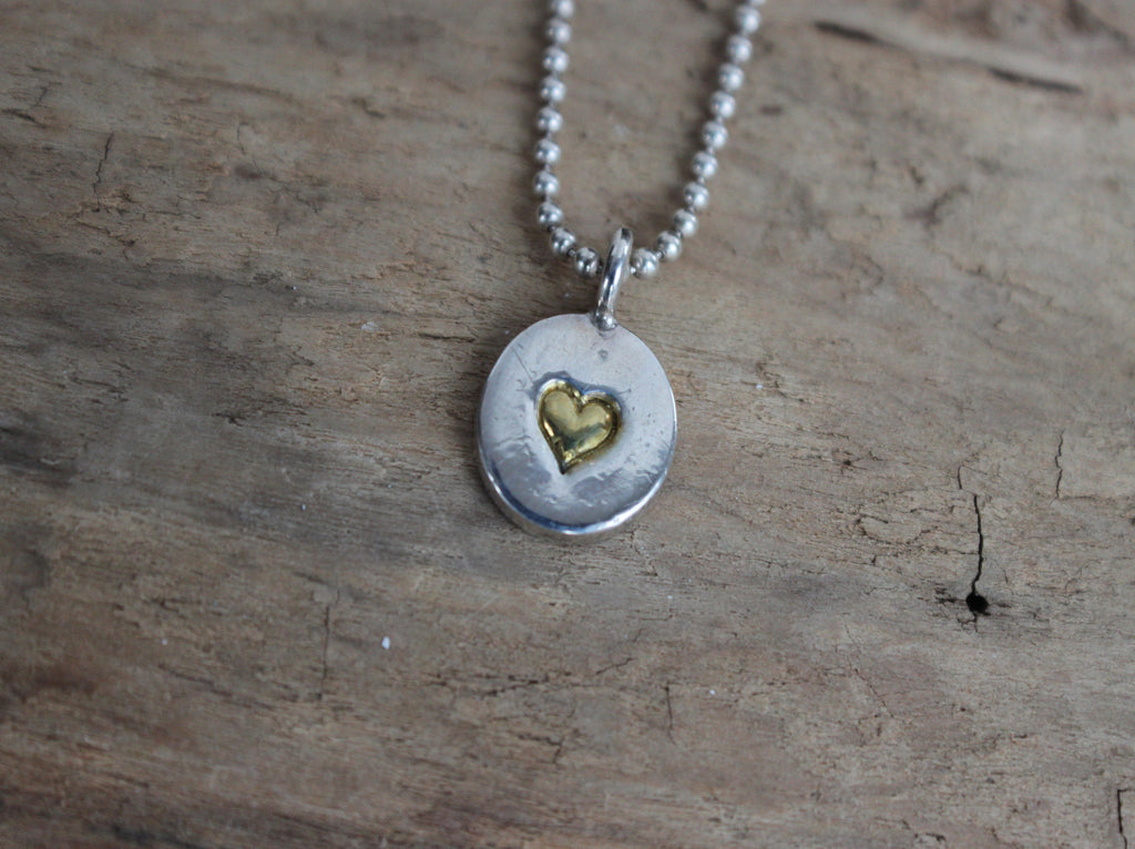 silver pendant with a hand stamped heart gilded in 22K gold by SFDesigns