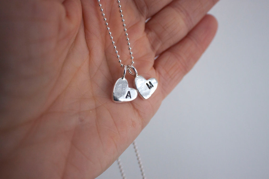 Personalized heart necklace.