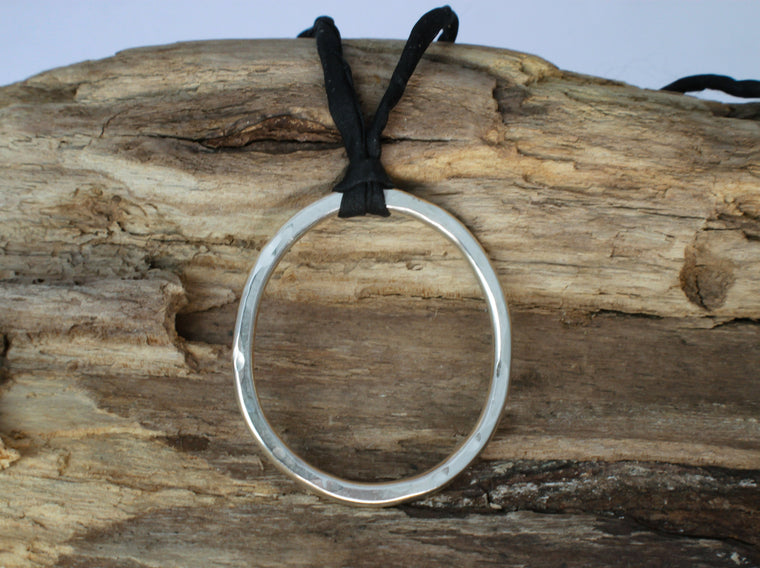 Circle of Hope - large silver circle on silk cord