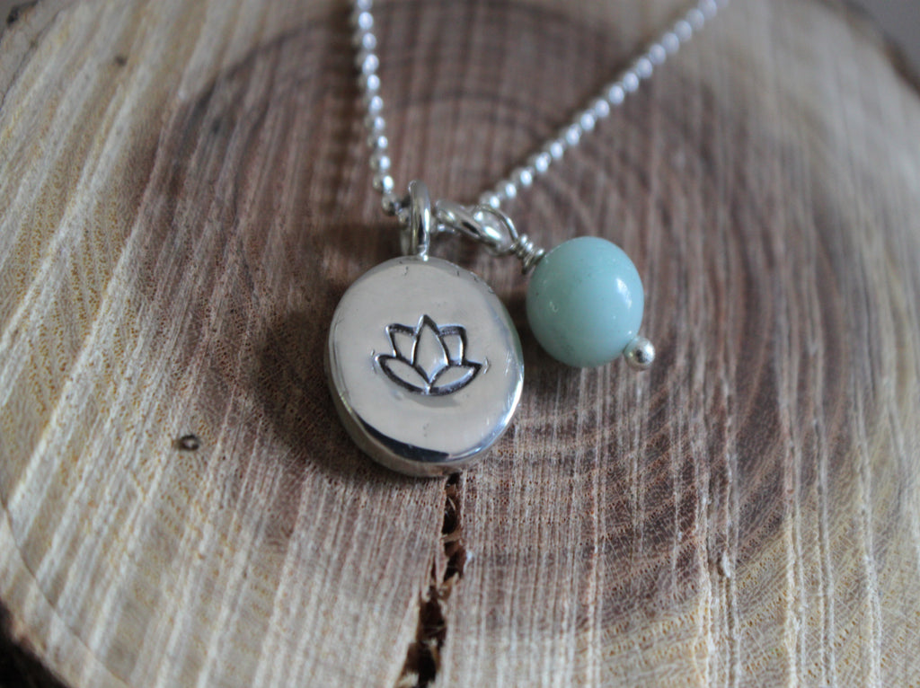 Silver lotus pendant with amazonite charm.