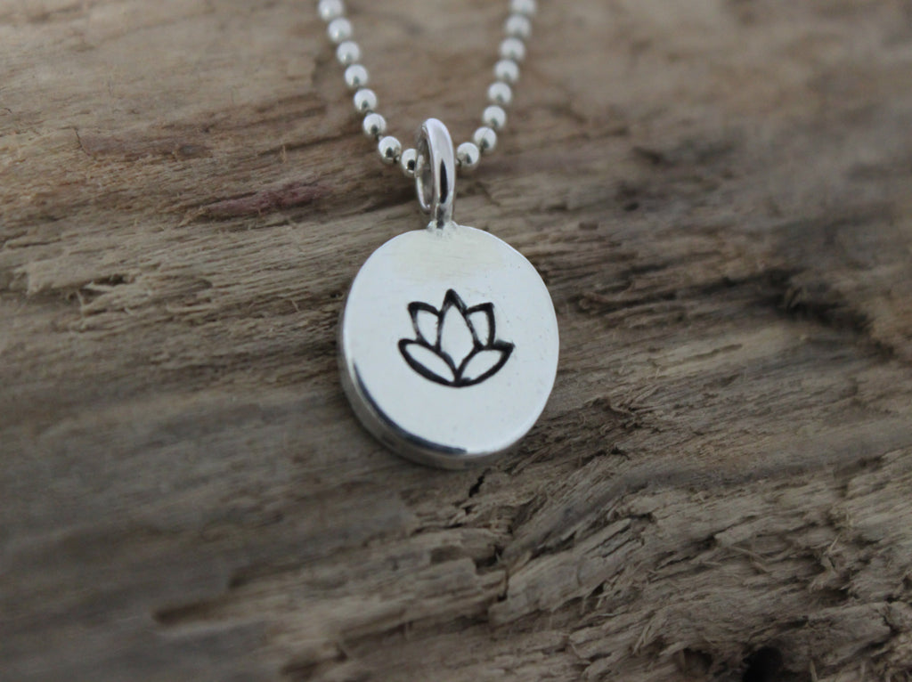 lotus symbol handstamped silver pendant by SFDesigns