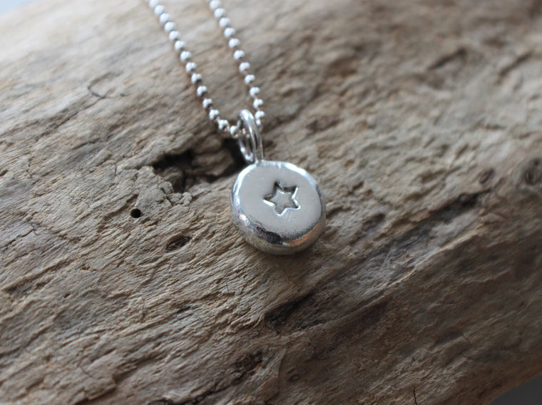 Silver star memorial necklace by SFDesigns.
