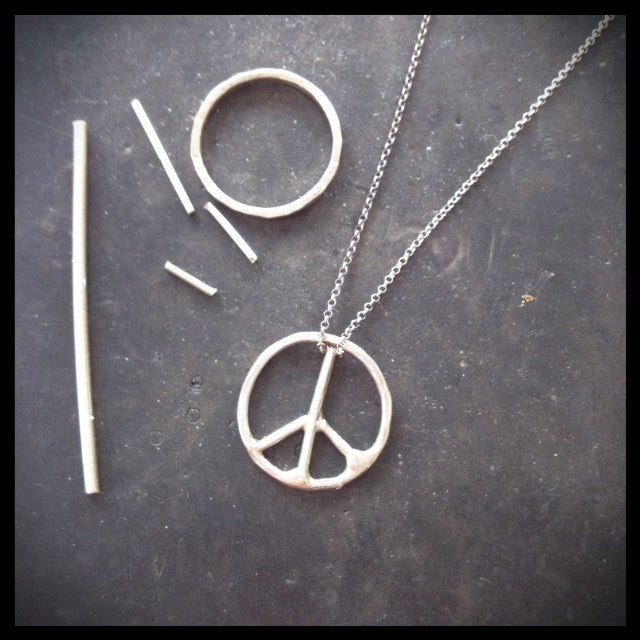illustration of silver scraps used to create peace sign ring