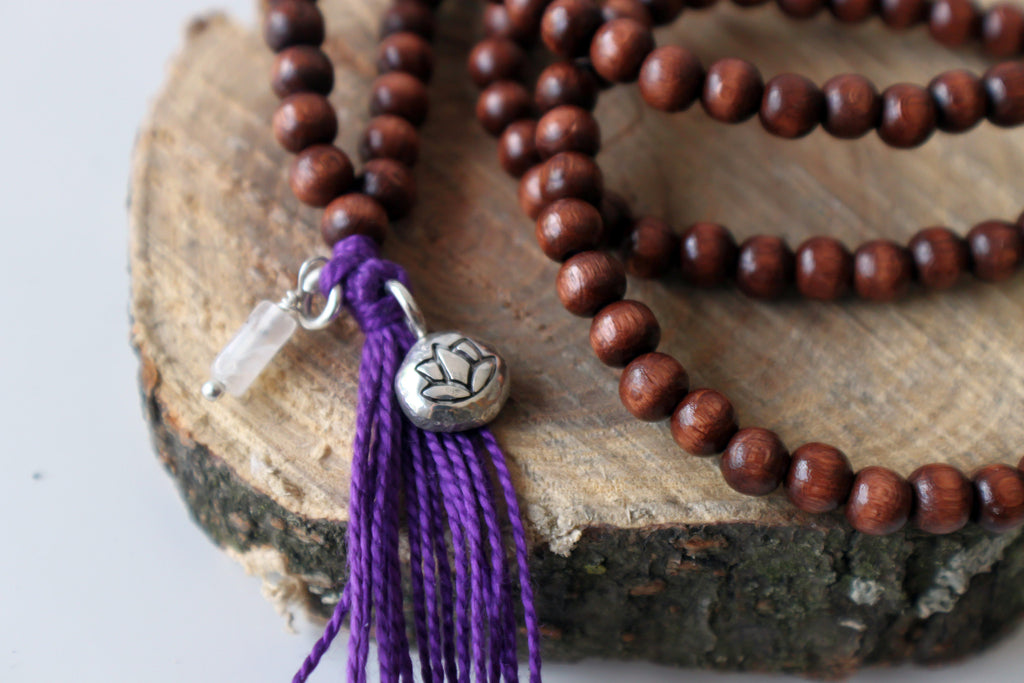 wooden mala necklace with lotus symbol