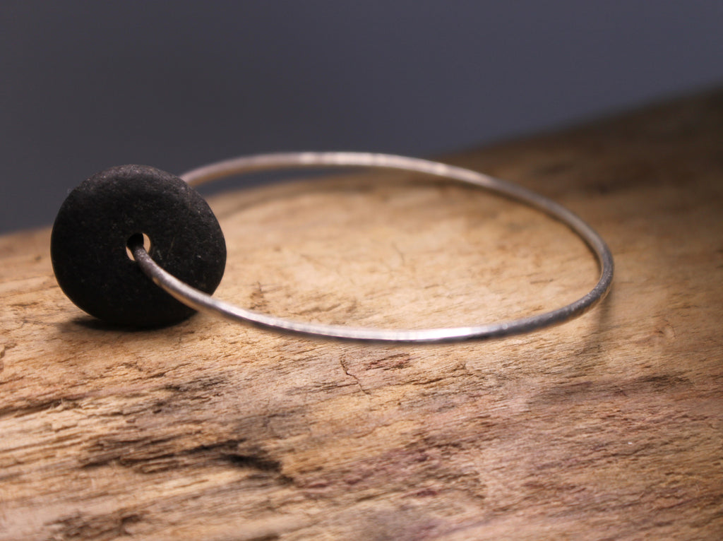 recycled sterling silver bangle with a floating natural beach stone. made in canada by SFDesigns.