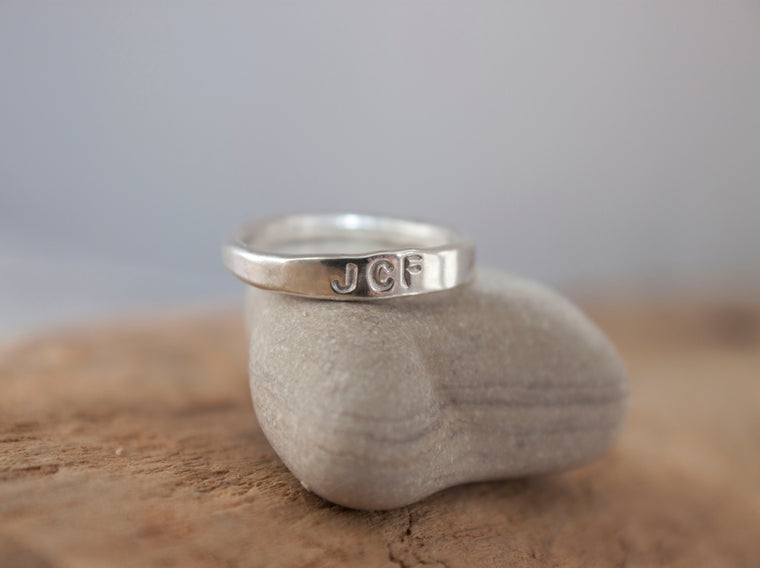 Simple Connection hand stamped silver initial stacking ring.