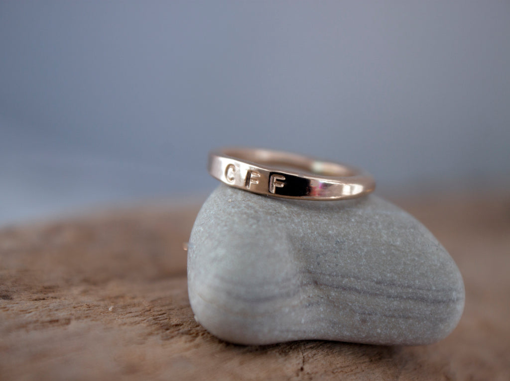 Simple Connection gold hand stamped stacking ring.
