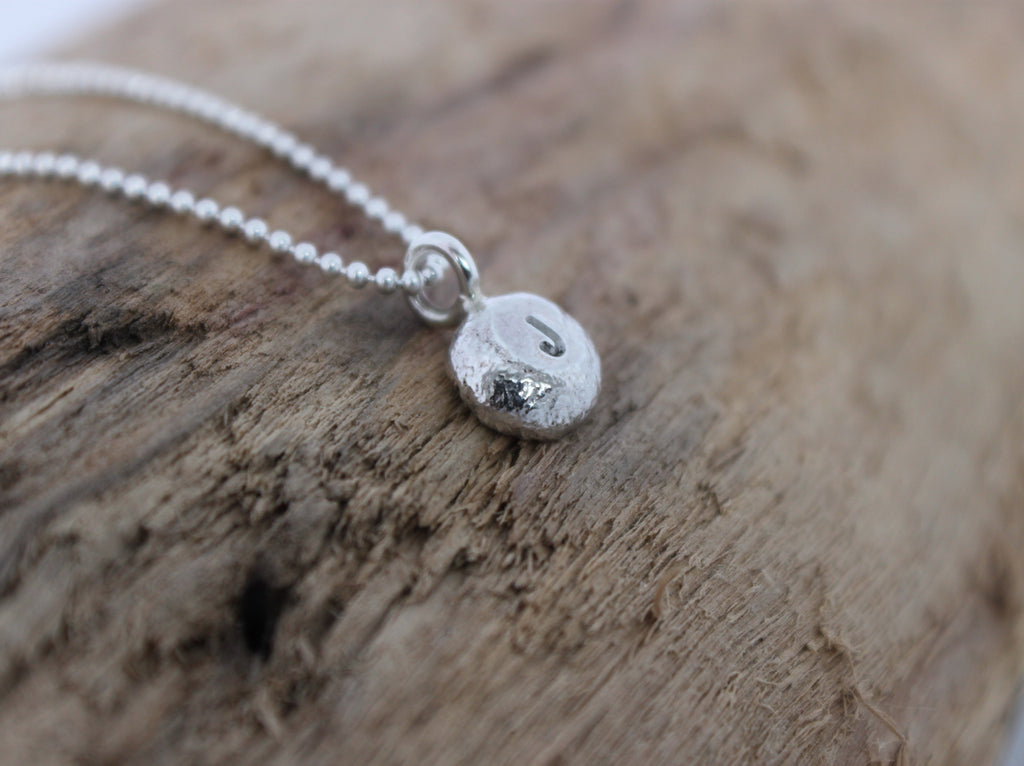 stepping stones silver pebble initial necklace