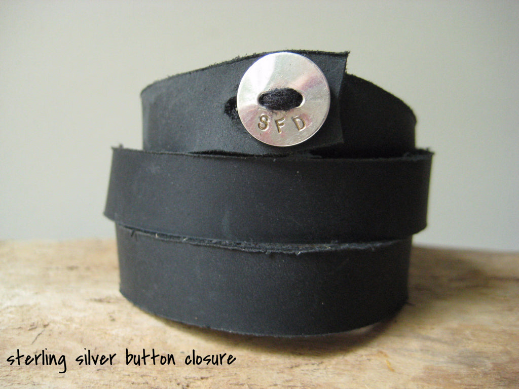 sample of sterling silver button closure on black leather wrap bracelet