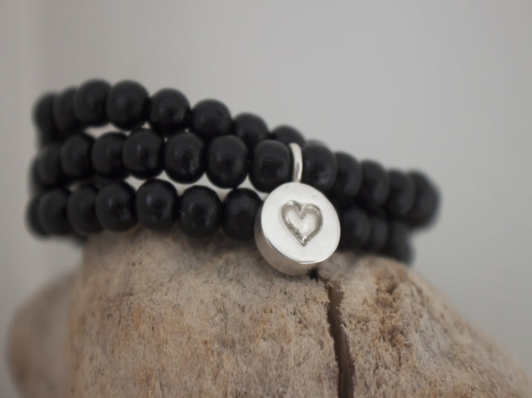 Wrapped in Love - wood bead bracelet with heart charm