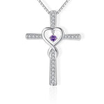 cross necklace with heart in the middle purple