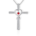 cross necklace with heart in the middle red