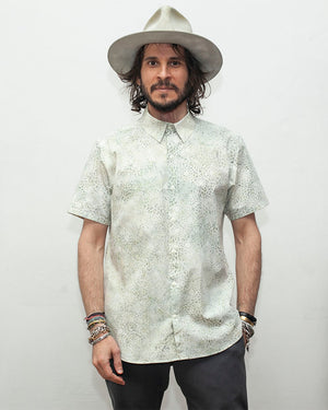 Men's Short Sleeve Collared Shirt with a light blue batik spot pattern - front