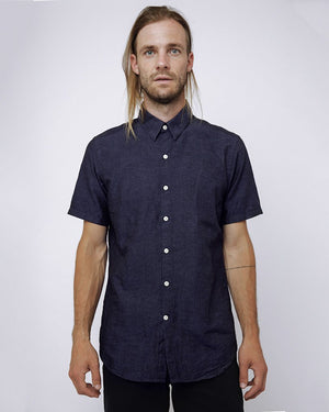 Short sleeve navy men's button up shirt with subtle dots - front