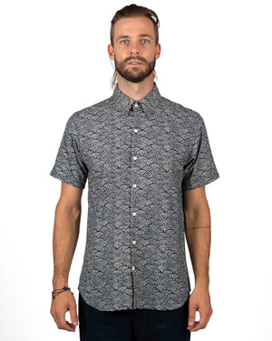 Men's navy short sleeve button up shirt with a subtle white waves pattern - front