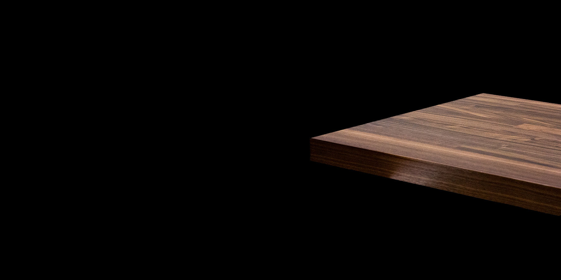 Walnut Butcher Block by RealCraft on a Black Background