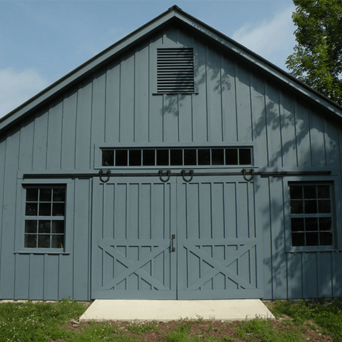 blue barn with double sliding barn doors