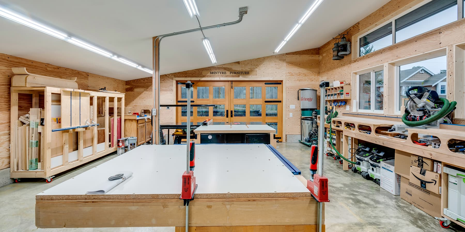 McIntyre Furniture woodshop interior view featuring the shop's new bright and clean look with new appliances and machinery.