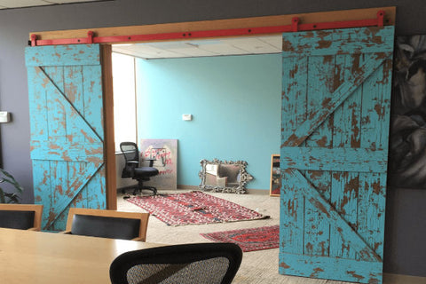 Bi Parting Barn Doors That Are Blue With A Rustic Grungy Finish Opening From A Conference Room To An Office