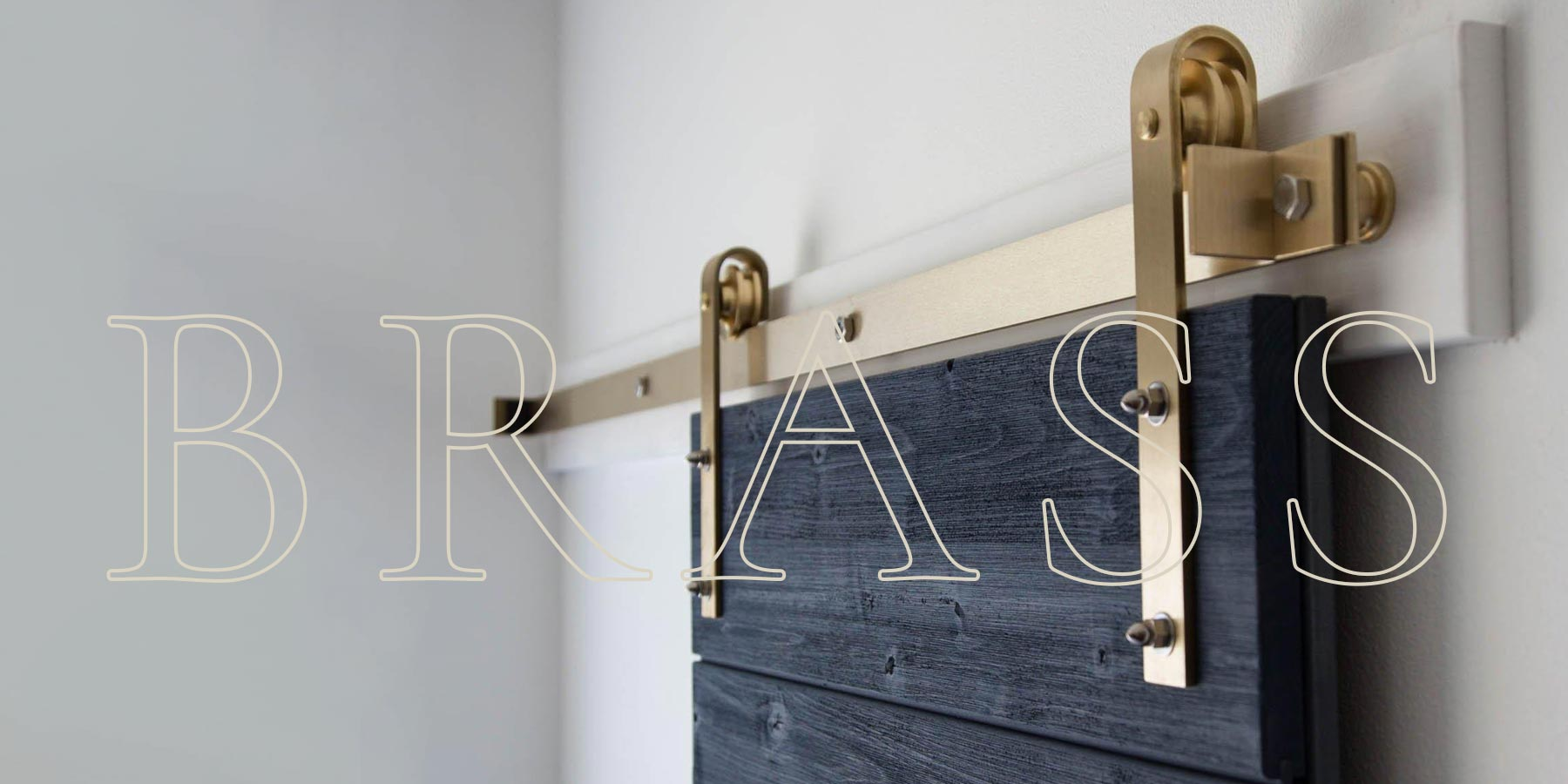 Word Brass over brass classic flat track installed on a blue door