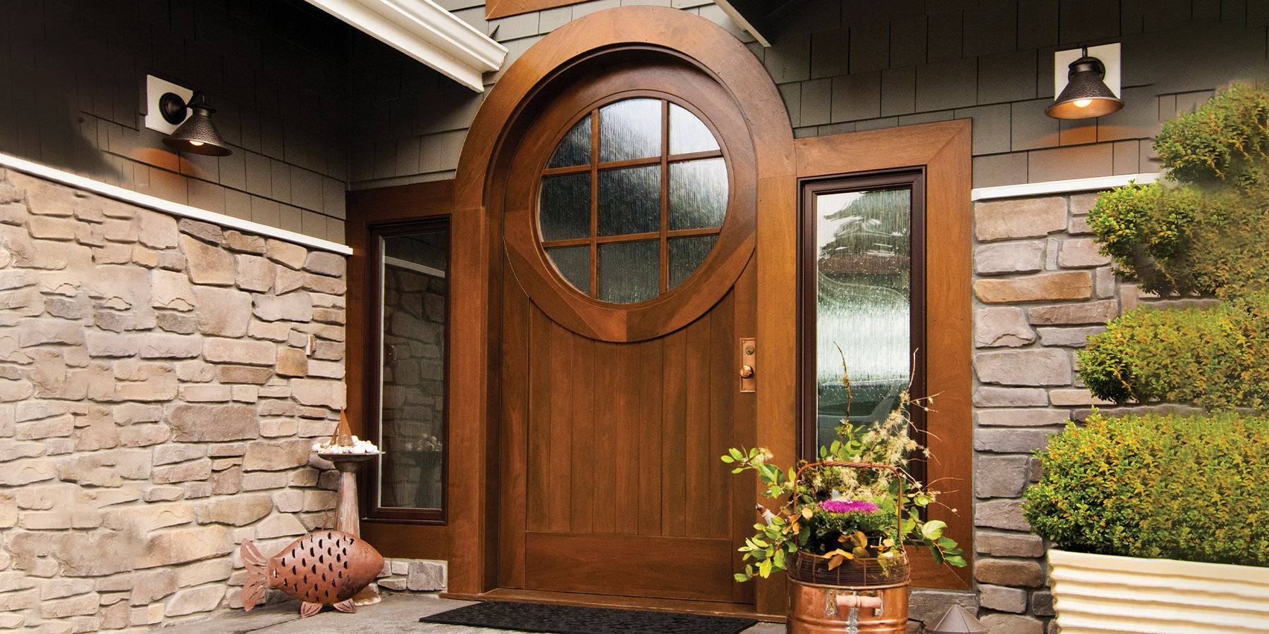 House entryway featuring a luxurious solid wood custom door design with la large circular window on the top area.