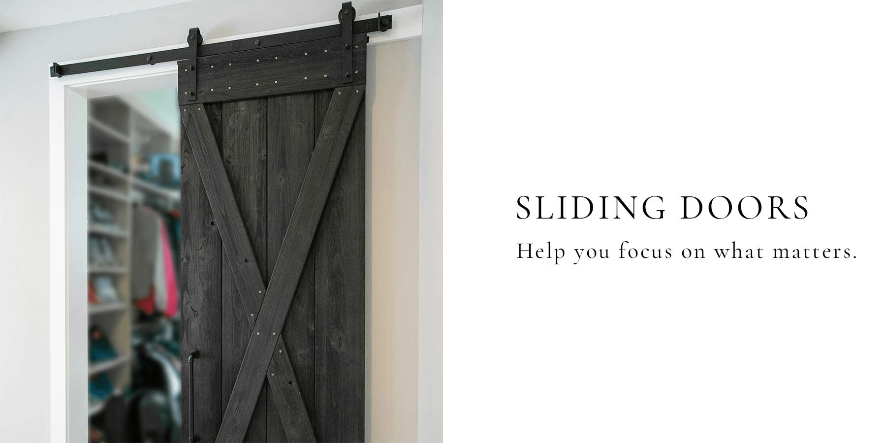 Weathered wood gray traditional barn door design installed in a closet space.